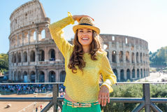 Smiling woman holding hat near Colosseum in Rome in summer Stock Photos