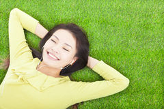Smiling  woman  holding head and lying Stock Image