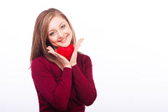 Smiling woman holding heart shape. Studio shot of young caucasian smiling woman isolated on white background holding heart shape Stock Images