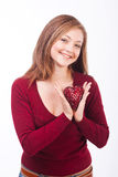 Smiling woman holding heart shape. Studio shot of young caucasian smiling woman isolated on white background holding heart shape for valentane day Stock Photos