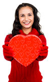 Smiling woman holding heart shape box Stock Images