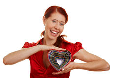 Smiling woman holding hearts Stock Photography
