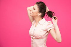 Smiling woman holding her hair Royalty Free Stock Image