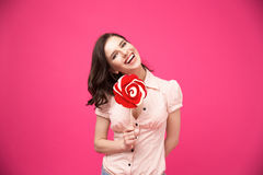 Smiling woman holding her hair Stock Images