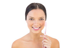 Smiling woman holding her teeth brush stock photo