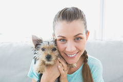 Smiling woman holding her yorkshire terrier puppy Royalty Free Stock Images