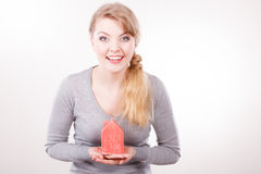 Smiling woman holding house model. Stock Image