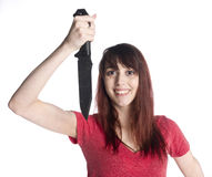Smiling Woman Holding Knife Looking at Camera Royalty Free Stock Photo