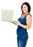 Smiling woman holding laptop Stock Image