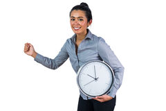 Smiling woman holding a large clock Royalty Free Stock Photo