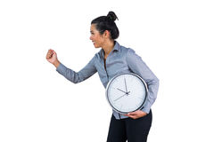 Smiling woman holding a large clock Stock Images