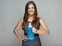 Smiling woman holding liquid detergent. Royalty Free Stock Images