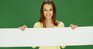Smiling woman holding a long banner Royalty Free Stock Images