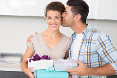 Smiling woman holding many gifts from her partner Stock Images