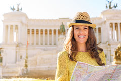 Smiling woman holding map at Venice Square in Rome in summer Royalty Free Stock Photos