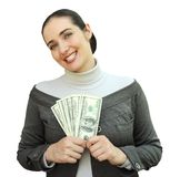 Smiling woman holding money Royalty Free Stock Images