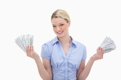 Smiling woman holding money in her hands Stock Photo