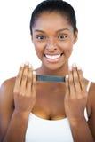 Smiling woman holding nail file Royalty Free Stock Photos