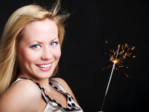 Smiling woman holding new year's sparkler Stock Photos