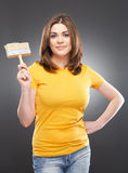 Smiling woman holding paint brush Royalty Free Stock Images