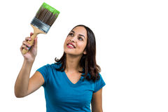 Smiling woman holding paint brush Stock Photo