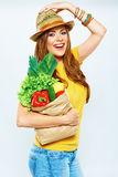Smiling woman holding paper bag with green vegan food Stock Images