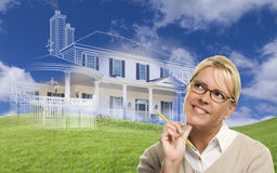 Smiling Woman Holding Pencil Looking to Ghosted House Drawing Be Royalty Free Stock Photo
