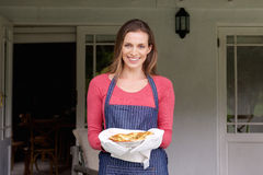 Smiling woman holding pie Royalty Free Stock Photo