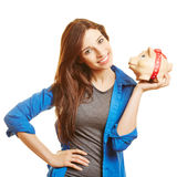 Smiling woman holding piggy bank Royalty Free Stock Photography