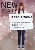 Smiling woman holding a placard with new year resolutions goals Royalty Free Stock Image
