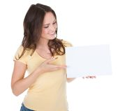 Smiling woman holding placard Royalty Free Stock Photography