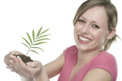 Smiling Woman Holding a Plant Royalty Free Stock Image