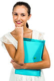 Smiling woman holding plastic holder with fist on chin Stock Image