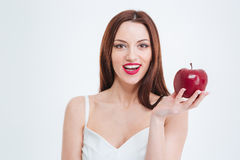 Smiling woman holding red apple Royalty Free Stock Images