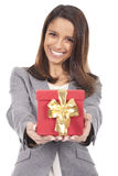 Smiling woman holding a red box gift Royalty Free Stock Photos