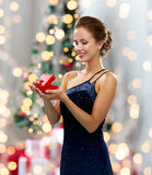 Smiling woman holding red gift box Royalty Free Stock Photography