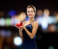 Smiling woman holding red gift box Royalty Free Stock Images