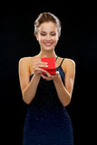 Smiling woman holding red gift box Stock Photo