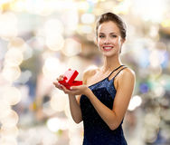 Smiling woman holding red gift box Stock Photography