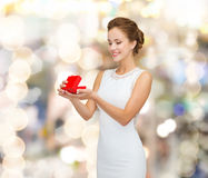 Smiling woman holding red gift box Stock Images