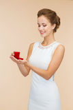 Smiling woman holding red gift box with ring Royalty Free Stock Photo