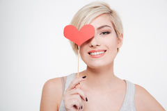 Smiling woman holding red heart Stock Photos