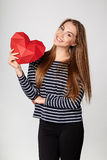 Smiling woman holding red polygonal paper heart shape Royalty Free Stock Photo
