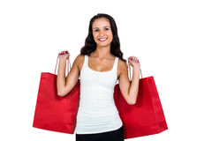 Smiling woman holding red shopping bags Royalty Free Stock Photos
