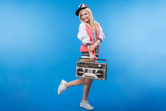 Smiling woman holding retro boom box Stock Photo