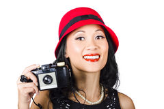 Smiling woman holding retro camera in hand Stock Photos