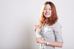 Smiling woman holding a rolled  newspaper Stock Images