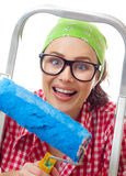 Smiling woman holding roller Royalty Free Stock Photo