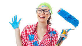 Smiling woman holding roller Royalty Free Stock Image