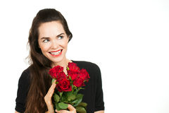 Smiling woman holding roses. A smiling beautiful woman holding a bunch of roses and looking at copy-space. Isolated on white stock images